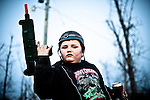 Sonny, 10, the stepson of Ron Edwards, plays army at the Klan compound where he lives. children frequently come over to the 20-acre compound to play and socialize, which furter exposes them to white power activity.