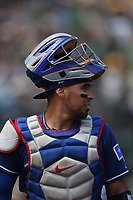 OAKLAND, CA - AUGUST 22:  Robinson Chirinos #61 of the Texas Rangers walks back to the dugout in between innings during the game against the Oakland Athletics at the Oakland Coliseum on Wednesday, August 22, 2018 in Oakland, California. (Photo by Brad Mangin)