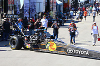 Apr 25, 2015; Baytown, TX, USA; Crew members back the car of NHRA top fuel driver Shawn Langdon out of their pit during qualifying for the Spring Nationals at Royal Purple Raceway. Mandatory Credit: Mark J. Rebilas-