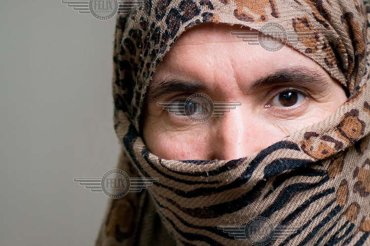 A portrait of a 38 year old Yazidi woman who was captured by Islamic State (IS) on 3 August 2014. After she spent several days in an industrial building with other villagers until 15 August she was sent to Syria with about 150 women. There she was given to an IS fighter from Tunisia as a gift. She was there until 3 March 2015. One day, she asked the IS fighter to give her a chance to talk to her family. Her family members negotiated  with him and finally decided to pay $ 1,700 to have her released. She heard that her 11 year old son is now in an IS training camp where children are being trained to become future fighters.