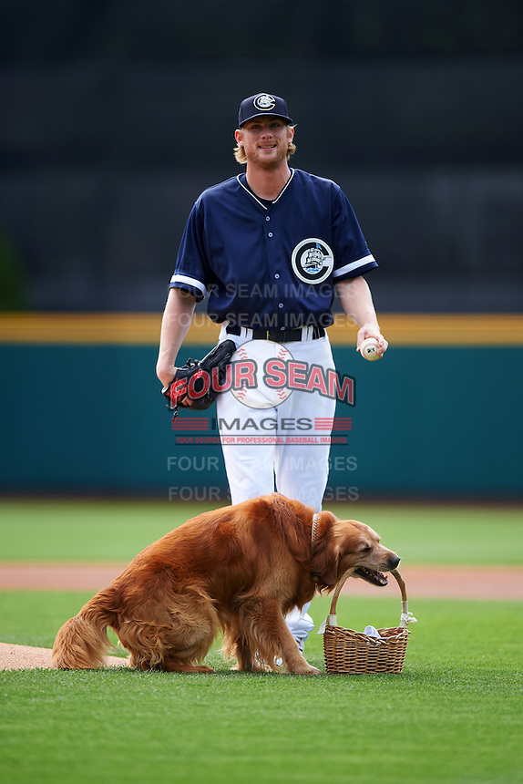 Columbus Clippers starting pitcher Ross Detwiler (41) waits for Jake the Diamond Dog to take the basket used to deliver the game ball off the field during a game against the Lehigh Valley IronPigs on May 12, 2016 at Huntington Park in Columbus, Ohio.  Lehigh Valley defeated Columbus 2-1.  (Mike Janes/Four Seam Images)