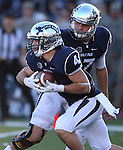 Nevada's Cody Fajardo hands off to Kendall Brock during the second half of an NCAA college football game against UNLV in Reno, Nev., on Saturday, Oct. 26, 2013.<br /> Photo by Cathleen Allison