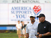 Bethesda, MD - July 4, 2007 -- Tiger Woods and caddie Army Sergeant Michael Wood walk the course during the inaugural Earl Woods Memorial Pro-Am.  Woods teed off in the early morning with AT&T Chairman Randall Stephenson, Army Sergeant Major Mia Kelly and Air Force Sergeant Andrew Amor for a round of 18 holes at Congressional Country Club in Bethesda, Maryland on Wednesday, July 4, 2007. Woods and company was later joined near the 16th hole by former United States President George H.W. Bush and his wife Barbara.  The commemorative occasion pays tribute to the many courageous men and women serving in our armed forces during the week of our nation's independence celebration. .Credit:  Johnny Bivera - DoD via CNP