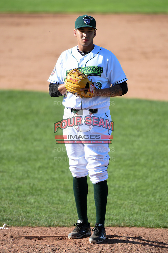 Jamestown Jammers pitcher Julio Eusebio (33) looks in for the sign during a game against the Mahoning Valley Scrappers on June 15, 2014 at Russell Diethrick Park in Jamestown, New York.  Jamestown defeated Mahoning Valley 9-4.  (Mike Janes/Four Seam Images)