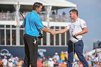 Greg Chalmers (AUS) shakes hands with Emiliano Grillo (ARG) on 18 following round 4 of the Houston Open, Golf Club of Houston, Houston, Texas. 4/1/2018.<br /> Picture: Golffile | Ken Murray<br /> <br /> <br /> All photo usage must carry mandatory copyright credit (&copy; Golffile | Ken Murray)