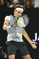 January 26, 2017: Roger Federer of Switzerland in action in a semifinals match against Stan Wawrinka of Switzerland on day 11 of the 2017 Australian Open Grand Slam tennis tournament in Melbourne, Australia. Photo Sydney Low