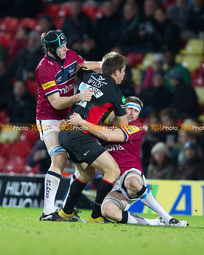 James Gaskell (Cap) and Richie Vernon (Sale Sharks) stifle Chris Wyles forward surge - Saracens RFC vs Sale Sharks RFC - Aviva Premiership Rugby at Vicarage Road Stadium, Watford Football Club - 06/11/11 - MANDATORY CREDIT: Ray Lawrence/TGSPHOTO - Self billing applies where appropriate - 0845 094 6026 - contact@tgsphoto.co.uk - NO UNPAID USE.
