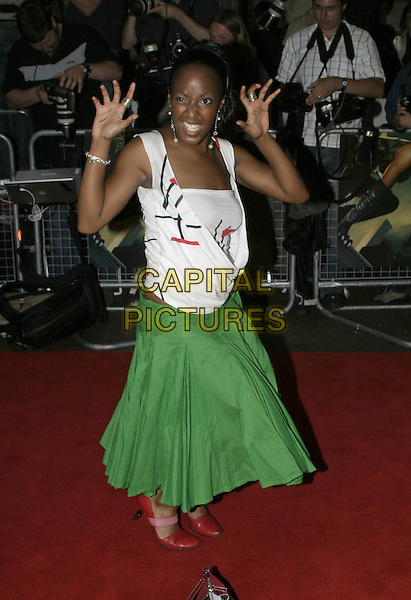 """ANGELICA BELL.""""Catwoman"""" film premiere arrivals .Vue Cinema, Leicester Square.London 03 August 2004.full length, gesture, hands, claws, green skirt, red shoes.www.capitalpictures.com.sales@capitalpictures.com.© Capital Pictures."""