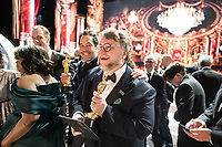 Guillermo del Toro (center) and Paul Denham Austerberry accept the Oscar&reg; for best motion picture of the year for work on &ldquo;The Shape of Water&rdquo; during the live ABC Telecast of The 90th Oscars&reg; at the Dolby&reg; Theatre in Hollywood, CA on Sunday, March 4, 2018.<br /> *Editorial Use Only*<br /> CAP/PLF/AMPAS<br /> Supplied by Capital Pictures