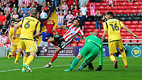 Lincoln City's Nathan Arnold sees his shot saved at close range from Morecambe's Barry Roche<br /> <br /> Photographer Chris Vaughan/CameraSport<br /> <br /> The EFL Sky Bet League Two - Lincoln City v Morecambe - Saturday August 12th 2017 - Sincil Bank - Lincoln<br /> <br /> World Copyright &copy; 2017 CameraSport. All rights reserved. 43 Linden Ave. Countesthorpe. Leicester. England. LE8 5PG - Tel: +44 (0) 116 277 4147 - admin@camerasport.com - www.camerasport.com