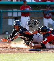 Thomas Neal  -  2009 San Jose Giants (California League) is tagged out at home by catcher Jose Yepez in a game against the High Desert Mavericks at Maverick Stadium, Adelanto, CA - 04/26/2009..Photo by:  Bill Mitchell/Four Seam Images