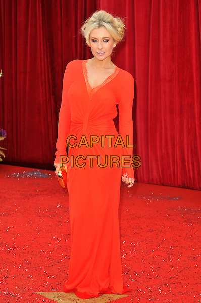 GEMMA MERNA .Attending the British Soap Awards 2011, .Granada Television Studios, Quay Street, Manchester, England, UK, .March 14th 2011..arrivals full length red long sleeve dress maxi gold clutch bag orange v-neck lace trim .CAP/CAS.©Bob Cass/Capital Pictures.