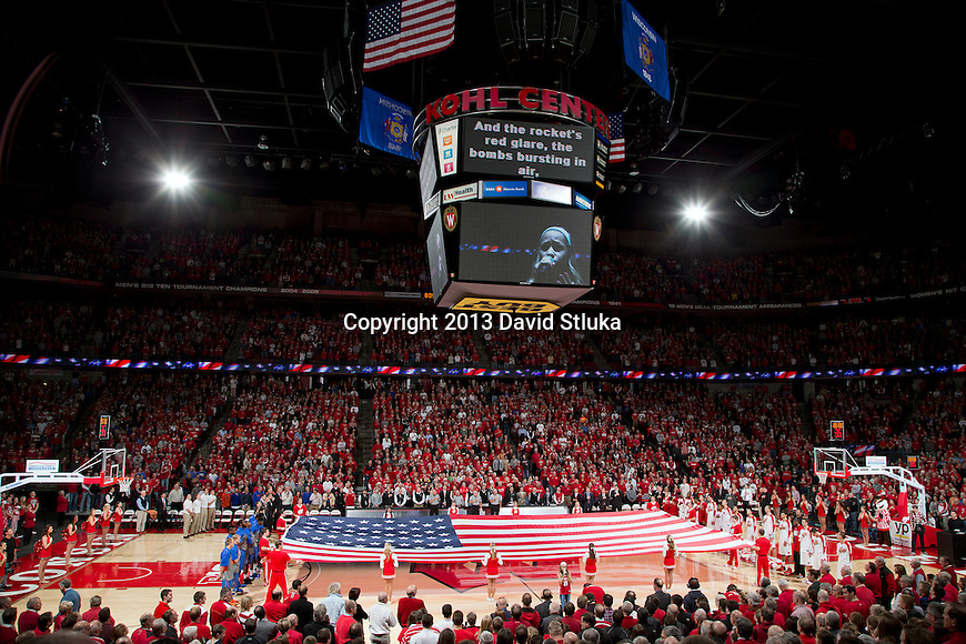 A general view of the Kohl Center during the National Anthem prior to the Wisconsin Badgers NCAA college basketball game against the Florida Gators Tuesday, November 12, 2013, in Madison, Wis. The Badgers won 59-53. (Photo by David Stluka)