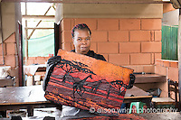 Africa, Swaziland, Malkerns.Nest organization artisan project, partnering with Baobab Batik & local artisans to help market their products to global markets and better sustain their local community. Women making batik, Busi.