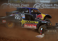 Apr 16, 2011; Surprise, AZ USA; LOORRS driver Kyle Leduc (99) races alongside Ricky Johnson (48) during round 3 at Speedworld Off Road Park. Mandatory Credit: Mark J. Rebilas-.