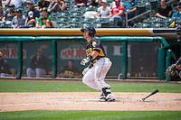 Daniel Robertson (13) of the Salt Lake Bees at bat against the Colorado Springs Sky Sox in Pacific Coast League action at Smith's Ballpark on May 24, 2015 in Salt Lake City, Utah.  (Stephen Smith/Four Seam Images)