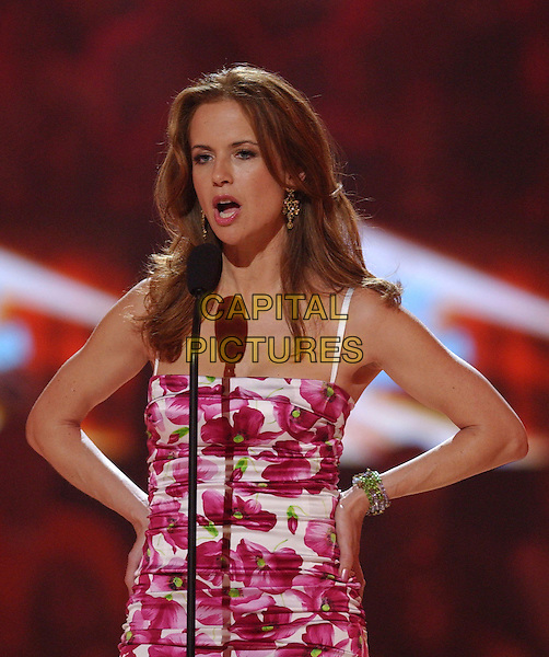 KELLY PRESTON.2006 CMT Music Awards held at The Curb Event Center at Belmont University, Nashville, Tennessee, USA - Telecast.April 10th, 2006.Photo: Laura Farr/AdMedia/Capital Pictures.Ref: LF/ADM.half length microphone pink floral print dress.www.capitalpictures.com.sales@capitalpictures.com.© Capital Pictures.