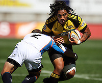 Richardt Strauss tackles Ma'a Nonu. Super 14 rugby union match, Hurricanes v Cheetahs at Yarrows Stadium, New Plymouth, New Zealand. Saturday 7 March 2009. Photo: Dave Lintott / lintottphoto.co.nz