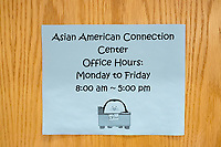 Signs hang on the door of the Asian American Connections Center at Middlesex Community College, on Thurs., Feb. 15, 2018. The Asian American Connections Center was established at the school using a federal grant in 2016 and serves as a focal point for the Asian community at the school, predominantly Cambodian, to gather, socialize, study, and otherwise take part in student life.