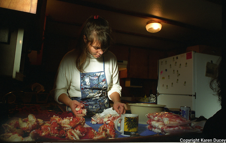 Donna Quashnick, cook onboard the F/V Maverick, prepares red king crab during an opener in November 1993.