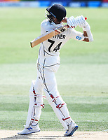 24th November 2019; Mt Maunganui, New Zealand;  Mitchell Santner hits a 6 on day 4 of the 1st international cricket test match, New Zealand versus England at Bay Oval, Mt Maunganui, New Zealand.  - Editorial Use