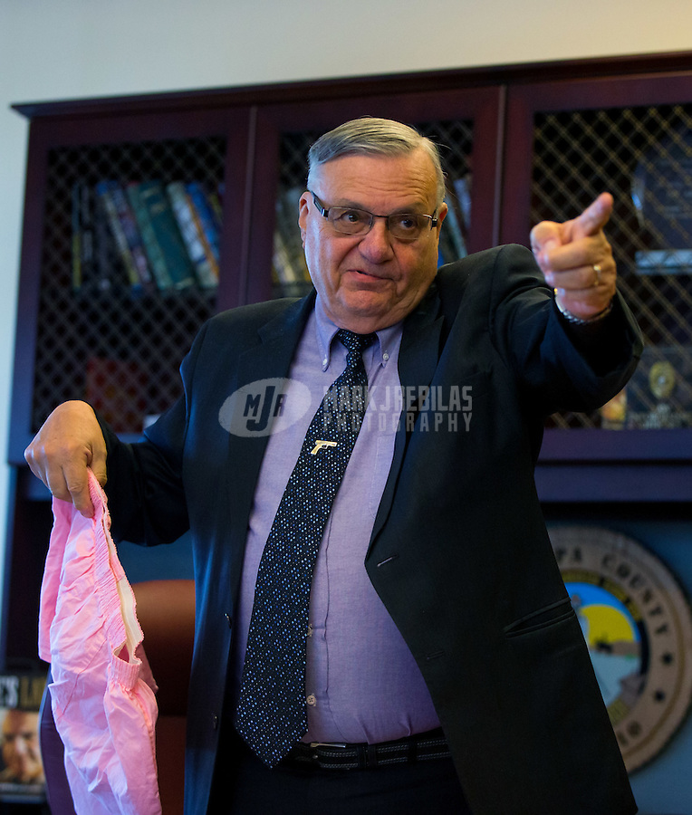 Jan 21, 2015; Phoenix, AZ, USA; Maricopa County sheriff Joe Arpaio reacts as he holds a pair of pink boxer underwear in his office in downtown Phoenix. Mandatory Credit: Mark J. Rebilas-