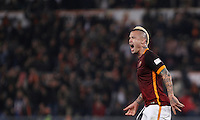 Calcio, Serie A: Roma vs Inter. Roma, stadio Olimpico, 19 marzo 2016.<br /> Roma&rsquo;s Radja Nainggolan celebrates after scoring during the Italian Serie A football match between Roma and FC Inter at Rome's Olympic stadium, 19 March 2016. The game ended 1-1.<br /> UPDATE IMAGES PRESS/Isabella Bonotto