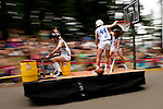 Adult SoapBox derby racers going through an S-Curve