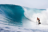 INDONESIA, Mentawai Islands, Kandui Resort, man surfing on a wave at a break called Bankvaults
