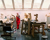 TURKEY, Istanbul, portrait of young woman artist standing in her studio at the Istanbul Universities studio