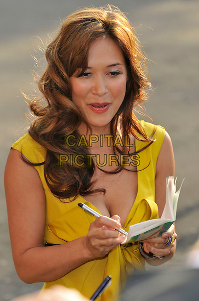 MYLEENE KLASS.Arrivals for the Classical Brit Awards 2008 held at the Royal Albert Hall, London, England, UK, 8th May 2008..half length yellow dress bow curly wavy hair signing autograph.CAP/CAN.© Phil Loftus/Capital Picturesmaxi long