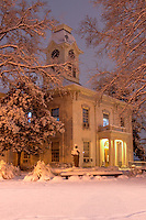 The Crawford County Courthouse in Van Buren Arkansas on Historic Main Street taken at night during a snow storm.