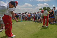 Jimmy Walker (USA) plays limbo with a long putt up on to the green on 3 as two volunteers hold cables above his shot during round 3 of the AT&amp;T Byron Nelson, Trinity Forest Golf Club, at Dallas, Texas, USA. 5/19/2018.<br /> Picture: Golffile | Ken Murray<br /> <br /> <br /> All photo usage must carry mandatory copyright credit (&copy; Golffile | Ken Murray)