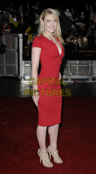 "CAMILLA KERSLAKE.Attending ""The Twilight Saga: New Moon"" Fan Event at the Battersea Evolution, London, England, UK, November 11th 2009..full length dress  beige sandals red cleavage low cut smiling .CAP/CAN.©Can Nguyen/Capital Pictures."