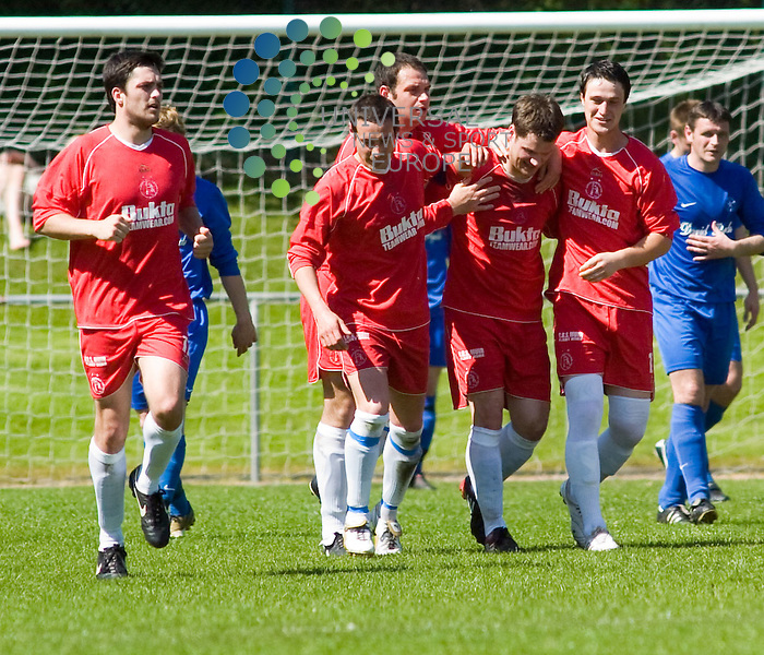 Lochee's Gary Middleton(centre of pic) is congratulated by his teammates after scoring, East Region Super League game, pictures by Colin LunnPicture 22 May Universal News and Sport (Europe)<br /> All pictures must be credited to  www.universalnewsandsport.com. (0ffice) 0844 884 51 22.