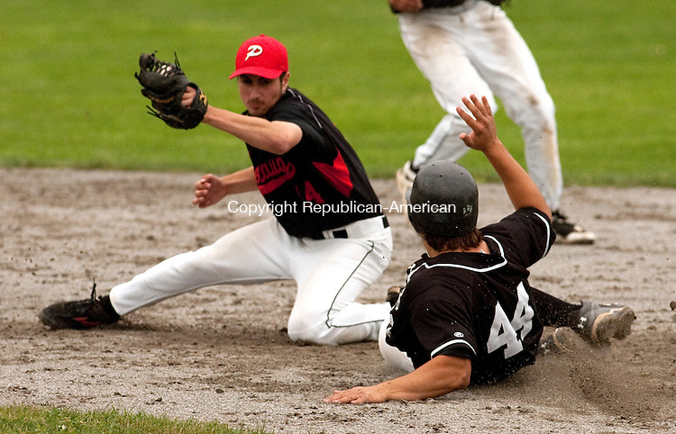 MIDDLETOWN, CT 13 JUNE, 2010-061310JS04- Xavier's Hayden Stanton (44) beats the tag by Pomperaug's Matthew Paola (14) during their Class LL state championship game Sunday at Palmer Field in Middletown. <br /> Jim Shannon Republican-American