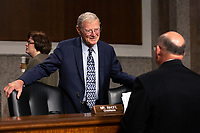 United States Senator Jim Inhofe (Republican of Oklahoma) speaks to Chief of Naval Operations Admiral Michael Gilday prior to his testimony before the United States Senate Committee on Armed Services at the U.S. Capitol in Washington D.C., U.S., on Tuesday, December 3, 2019.  The panel discussed reports of substandard housing conditions for U.S. service members. <br /> <br /> Credit: Stefani Reynolds / CNP /MediaPunch