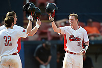 Illinois State Redbirds Danny Jackson (39) greeted by teammates after hitting a home run during a game against the Bowling Green Falcons on March 11, 2015 at Chain of Lakes Stadium in Winter Haven, Florida.  Illinois State defeated Bowling Green 8-7.  (Mike Janes/Four Seam Images)