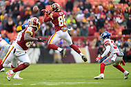 Landover, MD - December 9, 2018: Washington Redskins tight end Jordan Reed (86) jumps to catch a pass during game between the New York Giants and Washington Redskins at FedEx Field in Landover, MD. The Giants defeated the Redskins 40-16 dropping the Redskins to 6-7 on the season. (Photo by Phillip Peters/Media Images International)