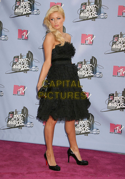 PARIS HILTON .2007 MTV Movie Awards held at the Gibson Amphitheater, Universal City, California, USA..June 3rd, 2007.full length dress black strapless sheer chiffon ruffles christian louboutin shoes clutch purse.CAP/ADM/RE.©Russ Elliot/AdMedia/Capital Pictures *** Local Caption *** ...