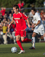 Rutgers University midfielder Nate Bourdeau (4) brings the ball forward.  Rutgers University defeated Boston College in penalty kicks after two overtime periods in NCAA Division I tournament action, at Newton Campus Field, November 20, 2011.