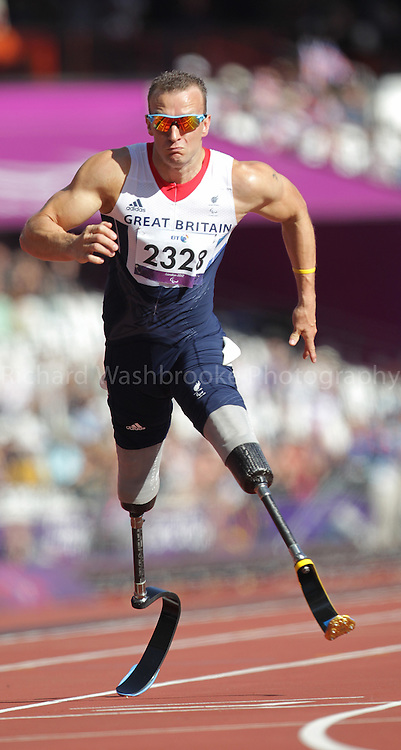 Paralympics London 2012 - ParalympicsGB - Athletics Men's 100m - T42 Round 1 held at the Olympic Stadium  7th September 2012..Richard Whitehead competing in the Men's 100m - T42 Round 1 held at the Olympic Stadium  7th September 2012 at the Paralympic Games in London. Photo: Richard Washbrooke/ParalympicsGB