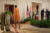 Washington, DC - November 24, 2009 -- First Lady Michelle Obama escorts Mrs. Gursharan Kaur, the wife of Prime Minister Manmohan Singh of India, at the conclusion of the State Arrival ceremony in the East Room of the White House, November 24, 2009. .Mandatory Credit: Pete Souza - White House via CNP