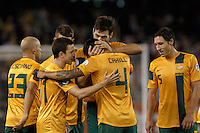 MELBOURNE, 11 JUNE 2013 - Australian players celebrate their win in a Round 4 FIFA 2014 World Cup qualifier match between Australia and Jordan at Etihad Stadium, Melbourne, Australia. Photo Sydney Low for Zumapress Inc. Please visit zumapress.com for editorial licensing. *This image is NOT FOR SALE via this web site.