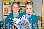 Twins Cathy and Megan Kiely could wait to get started at the Holy Family National School in Rathmore on Monday. ...........