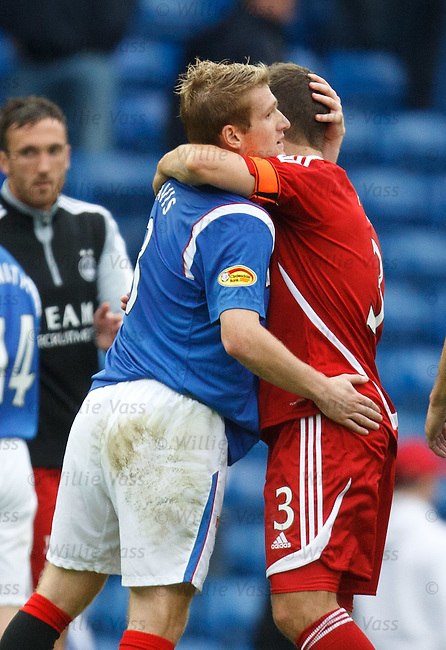 Richard Foster at full time congratulating his ex-Rangers team mates