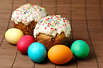 Traditional for Russia Easter cakes and colorful painted Easter eggs, artistic still life.