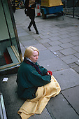 Young homeless woman begging in central London