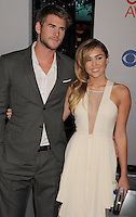 LOS ANGELES, CA - JANUARY 11: Liam Hemsworth and Miley Cyrus arrive at the People's Choice Awards 2012 at Nokia Theatre LA Live on January 11, 2012 in Los Angeles, California.