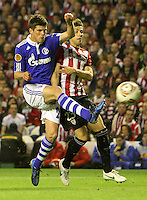 5.04.2012 Bilbao, Spain. Uefa Europa League. Picture show Huntelaar (L) and Ekiza (R) in action during match between Athletic Club against Shalke 04 at San Mames stadium